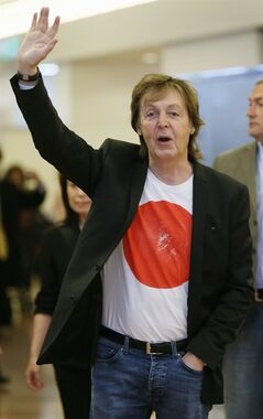 In this Thursday, May 15, 2014 photo, Paul McCartney waves upon arrival at Haneda international airport in Tokyo. McCartney canceled his show in Tokyo Saturday, May 17, 2014 after he came down with a virus, but will make up for the lost performance Monday. The former Beatle said he plans to be well enough for Sunday�s concert, although Saturday�s �Out There Japan Tour 2014� appearance at Tokyo's National Stadium was called off. (AP Photo/Kyodo News) JAPAN OUT, CREDIT MANDATORY