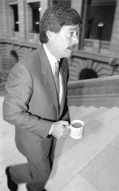 "My favourite photo of former city councillor Jim McCrae was taken by myself when he had just been appointed attorney general after being re-elected in 1988. He's seen quickly ascending the grand staircase in the Manitoba legislature on his way to a meeting. The father of five is carrying a mug that states ""I Love my Daddy."" McCrae, who is also a real estate agent and published author, quit as Meadows ward councillor this week to be a part-time citizenship judge, for now, in Winnipeg."