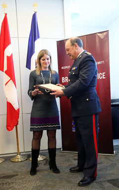 Brandon Police Service Chief Ian Grant presents Glenda Zelmer, a counsellor at Crocus Plains Regional Secondary School, with a Citizen Recognition Award during the Brandon Police Service awards ceremony at their headquarters on 10th Street on Thursday. Zelmer acted on a tip about a student attempting suicide in 2013 and helped to save his life.