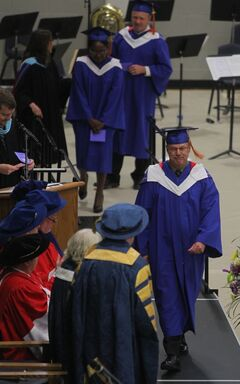 Brandon Police Chief Ian Grant received his Masters degree in Rural Development at Brandon University's convocation ceremony on Friday morning.