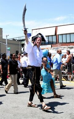Mayor Bill de Blasio marches in the Mermaid Parade in the Coney Island section of the Brooklyn borough of New York, Saturday, June 21, 2014. Organizers say de Blasio is the first mayor of New York City to take part in Coney Island's zany Mermaid Parade in costume. (AP Photo/Tina Fineberg)