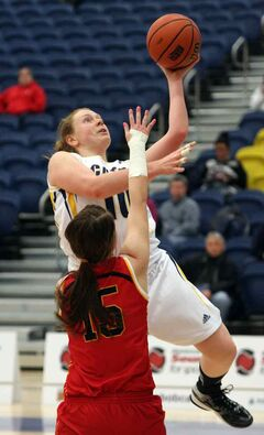 Bobcats forward Aimee Johnston rises up to sink a left-handed layup over a Calgary Dinos defender Friday.