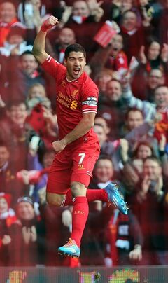 Liverpool's Luis Suarez celebrates scoring his team's opening goal during their English Premier League soccer match against Cardiff City at Anfield, Liverpool, England, Saturday, Dec. 21, 2013. (AP Photo/Peter Byrne, PA Wire) UNITED KINGDOM OUT - NO SALES - NO ARCHIVES