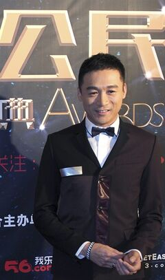 In this photo taken Tuesday, March 18, 2014, actor Gao Hu poses on the red carpet during the award ceremony of the Celebrity Citizens in Beijing, China. Gao, 40, who had a small part as a soldier in Zhang Yimou's 2011 movie