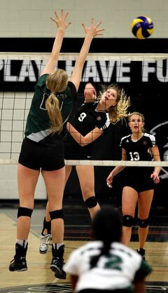 Westwood Warrior Nikki Majewski (9) hammers a kill in high school action earlier this season.