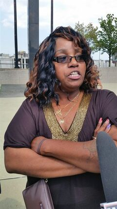 "Bernita Spinks, aunt of slaying victim Renisha McBride, speaks to reporters outside the Wayne County Circuit Court building in Detroit, on Thursday, Aug. 7, 2014, after a jury found Theodore Wafer guilty of second-degree murder in the shotgun death of McBride, 19. Wafer shot McBride on Nov. 2, 2013, his porch in the Detroit suburb of Dearborn Heights after she banged on his door in the middle of the night. Spings said the killing showed the danger of the thoughtless use of firearms and didn't reflect any racial motive by the white homeowner. Spinks said people need to use ""the right judgment"" if they are going to have guns in their homes. (AP Photo/David N. Goodman)"
