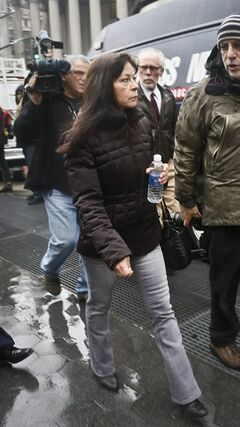"Elizabeth Valle is surrounded by news reporters as she leaves court on Tuesday, March 12, 2013 in New York. A federal jury convicted her son, New York City police officer Gilberto Valle, of charges he plotted to kidnap and cook women to dine on their ""girl meat."" Valle, 28, faces up to life in prison when he is sentenced on June 19. With the conviction, he loses his job as a police officer. (AP Photo/Bebeto Matthews)"