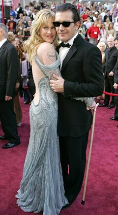 FILE - This Feb. 27, 2005 file photo shows actor Antonio Banderas with his wife Melanie Griffith, left, at the 77th Academy Awards in Los Angeles. Griffith is sporting a tattoo with Antonio's name. Griffith filed for divorce from Banderas on Friday June 6, 2014 in Los Angeles, citing irreconcilable differences as the reason for the end of their 18-year marriage. (AP Photo/Laura Rauch, File)