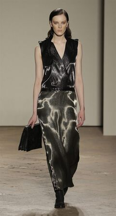 A model wears a creation for Gabriele Colangelo women's Fall-Winter 2013-14 collection, part of the Milan Fashion Week, unveiled in Milan, Italy, Friday, Feb. 22, 2013. (AP Photo/Luca Bruno)