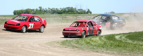 Cars round a corner at Souris Speedway during PASCAR races in May. The track is celebrating its grand reopening on Sunday.