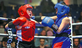 Wyatt Robinson, left, of the Brandon Boxing Club squares off against Gage Lee of the Alliance Boxing Club in an exhibition bout at the Keystone Centre Amphitheatre on Saturday.