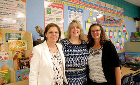 Lori Patterson, from left, Cheryl Danis and Karen Taylor — the three remaining teachers who have taught at Waverly Park School since it opened 25 years ago — pose for a photo during the celebration on Thursday to mark the milestone.
