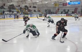 Justin Metcalf circles away from a Portage Terriers defender at the Yellowhead Centre. It's the work behind the scenes that keeps the Manitoba Junior Hockey League team afloat. (Eoin Devereux/Neepawa Banner/Neepawa Press)