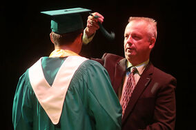Neelin Principal Michael Adamski confers a student by passing the capboard's tassel to the left side during Tuesday's graduation ceremony for École secondaire Neelin High School at the Western Manitoba Centennial Auditorium.