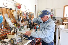 Herb Goulden with the Friends of the Bluebirds works on a Bluebird box in the garage of his home on Thursday.