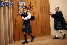 Evan Dyson pipes in the haggis, carried by Brent Lowrie during the Westman Scottish Association's annual Robbie Burns Dinner at Sokol Hall on Saturday evening. The famous Scottish poet was born on Jan. 25, and his life and work are celebrated in Scotland and by Scottish expats the world over.