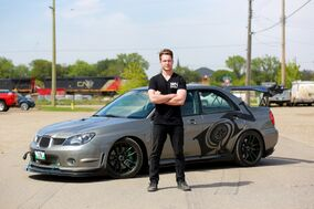 Leland Kirton of Ion Coating with his custom 2006 Subaru STI that he has modified with handmade parts.