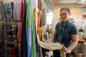 Lynn Nightingale of Ten Thousand Villages sorts through a selection of handmade Indian scarfs, made of cotton or silk, which could make that special Mother's Day gift.