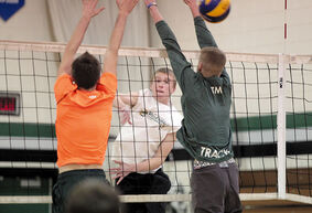 Andrew Paul hits the ball over the net during varsity boys' volleyball practice at Neelin high school on Wednesday night as the Spartans gear up for provincials.