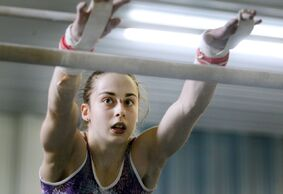 Isabela Onyshko, seen here practising on the bars at the Brandon Eagles Gymnastics Club, can take one step closer to earning a spot on the Canadian Olympic team at the national championships this week in Edmonton.