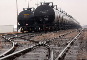 Tanker cars run the length of the CN Rail yards between First Street and 17th Street East on Wednesday as the federal government ordered 5,000 dangerous tank cars off the rails as part of safety recommendations after the deadly derailment and fire in Lac-Mégantic, Que., last summer.