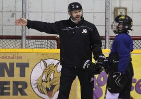 Former Brandon Wheat Kings forward Jeff Hoad explains a drill to a member of the young team he coaches during a practice at the Sportsplex last week.