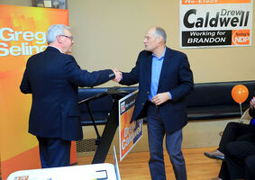 Premier Greg Selinger shakes hands with Drew Caldwell during a nomination meeting for the Brandon East NDP MLA Thursday evening at the East End Community Centre. Caldwell is gearing up for his fifth provincial election campaign this April.