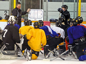 Brandon Bantam AAA Wheat Kings coach Chris Johnston diagrams a play for his players during a practice at the Sportsplex on Wednesday evening.