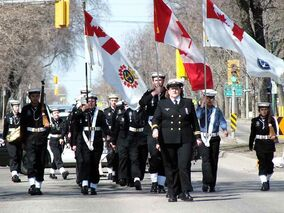 Led by Swiftsure's commanding officer Lt. (N) Deb McArthur, cadets march out onto Victoria Avenue in front of the Armoury during the Battle of Atlantic parade.