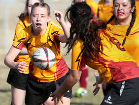 Britney Stradler passes the ball to a Crocus Plains teammate during a high school rugby match with Vincent Massey at John Reilly Field on Tuesday afternoon.