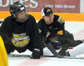 Jayce Hawryluk laughs as he stretches with the kids at the Brandon Wheat Kings Hockey School Monday afternoon at Westman Place. Hawryluk is preparing for the Canadian junior team's selection camp, which begins this weekend.