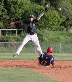 Canadian Tire Cardinals' Kevin McNarland slides into second with a stolen base as Midget Knights shortstop Carson Boyechko leaps for the ball during an Andrew Agencies senior AA baseball game Wednesday.
