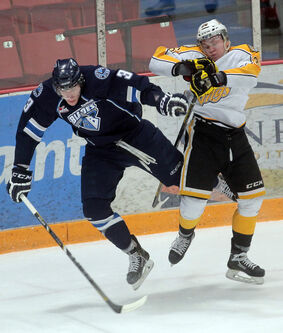 Brandon's Ryley Lindgren, right, collides with Saskatoon's David Nemecek on Tuesday at Westman Place.