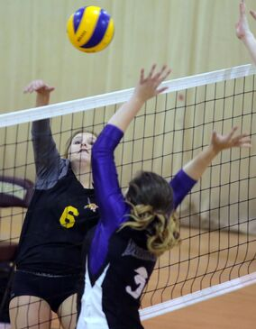 Crocus Plains' Danielle Woychyshyn hits the ball around the block provided by Vincent Massey's Kate Fergusson during Brandon High School Volleyball League varsity girls' play at Crocus Plains on Tuesday evening.