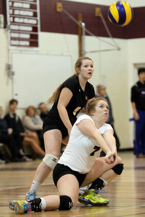 Mackenzie Pearson digs the ball for the Crocus Plainsmen last night versus Vincent Massey.