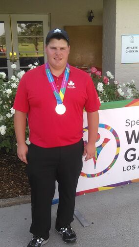 Danny Peaslee of Sourris poses with his gold medal after winning the golf competition at the Special Olympics World Games in Los Angeles Friday.