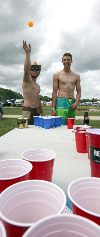 Austin Nafostowicz throws a ping-pong ball while partner David Hicks looks on. The pair came from Winnipeg to Dauphin for Countryfest.