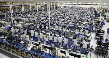 FILE -In this Tuesday, Sept. 10, 2013, file photo, workers man the Motorola smartphone plant in Fort Worth, Texas. The Federal Reserve reports on industrial production for March later Wednesday April 16, 2014. (AP Photo/LM Otero, File)