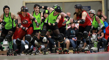 In this May 2012 photo, Sheena Ford, centre, a.k.a. SheNasty N2O, breaks through the pack for the Westman Gang Green in a bout against Lil Chicago from Moose Jaw, Sask., during Wheat City Roller Derby League action at CFB Shilo. Gang Green takes on the Gapland Rollers in Wheat City Roller Derby League action at Shilo on Saturday night.