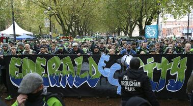 Members of the Emerald City Supporters and other fans take part in the traditional march to the match before an MLS soccer match between the Seattle Sounders and the Los Angeles Galaxy, Saturday, Oct. 25, 2014, in Seattle. (AP Photo/Ted S. Warren)