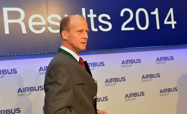 Tom Enders, the chief executive of Airbus Group arrives prior to the Airbus Group press conference on the 2014 annual results in Munich, Germany, Friday, Feb. 27, 2015. Airbus said its net profit soared 59 percent last year as a record-high number of jet deliveries helped offset a 551 million euros end-of-year charge against its delayed A400M military transporter program. (AP Photo/ Kerstin Joensson)