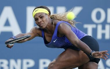Serena Williams returns the ball during the second set of her match against Karolina Pliskova in the Bank of the West Classic Tennis Tournament, Wednesday, July 30, 2014, in Stanford, Calif. (AP Photo/Beck Diefenbach)