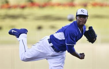 Kansas City Royals starting pitcher Yordano Ventura watches a delivery to the Seattle Mariners in the first inning of a spring training baseball game Friday, March 27, 2015, in Surprise, Ariz. (AP Photo/Lenny Ignelzi)