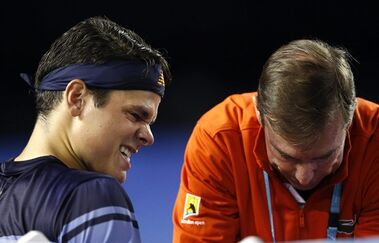 Milos Raonic of Canada reacts as he receives treatment from a trainer during his semifinal match against Andy Murray of Britain at the Australian Open tennis championships in Melbourne, Australia, on Jan. 29, 2016. Canadian tennis player Milos Raonic has been unable to resume on-court training due to a slightly torn adductor muscle that hampered his play in a semifinal loss to Andy Murray at the Australian Open last month.Raonic had difficulty pushing off his right leg in the later stages of the four-hour match and Murray took the last two sets for the win. He said he has been able to do strength work and off-court training since then but hasn't hit balls because of the two-centimetre tear in the adductor. THE CANADIAN PRESS/AP, Rafiq Maqbool