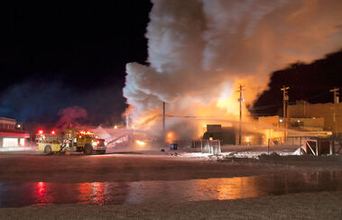 Firefighters battle a blaze that destroyed Neepawa's Home Hardware store on Wednesday evening.
