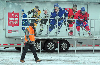 A member of the setup crew with the Rogers Hometown Hockey Tour walks around the Keystone Centre grounds on Thursday afternoon as organizers prepare for this weekend's televised event.