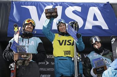 First-place finisher Joss Christensen, center, is flanked by second-place Mcrae Williams, left, and third-place Gus Kenworthy on the podium after the World Cup freestyle skiing event Friday, Feb. 27, 2015, in Park City, Utah. (AP Photo/Rick Bowmer)