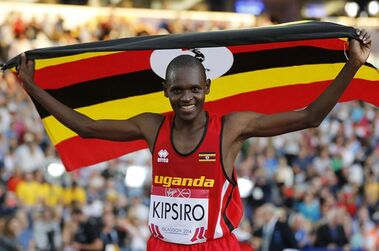 FILE - In this Friday, Aug. 1, 2014 file photo, Moses Kipsiro of Uganda celebrates after winning the 10,000m final during the Commonwealth Games 2014 in Glasgow, Scotland. The Ugandan Athletics Federation says it is investigating claims made by Kipsiro that he received a death threat from a coach, while police said Wednesday April 1, 2015, they had arrested a relative of the runner on suspicion of setting the coach's house on fire. (AP Photo/Frank Augstein, File)