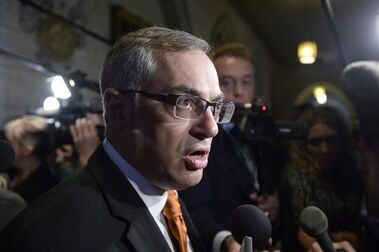 Treasury Board President Tony Clement fields questions in the foyer outside the House of Commons in Ottawa, Monday, May 11, 2015. The president of the NDP riding association in Ontario's Parry Sound-Muskoka is intent on