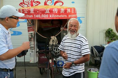 Chen Guan Ming, a farmer from southern China, packs up his rickshaw during a stop in Brandon on Tuesday. The 58-year-old started his journey in 2008 when he cycled 800 kilometres to the Olympic host city of Beijing. He then cycled across Asia and Europe to the 2012 London Games and is now heading across North and South America as he makes his way to Rio de Janeiro, host city of the 2016 Games.